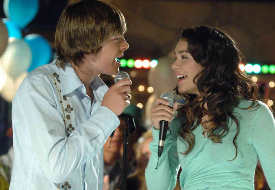 Actors Zac Efron, as basketball star Troy, left, and Vanessa Anne Hudgens, as the shy academic Gabriella, in High School Musical, seen in this undated photo released by the Disney Channel.