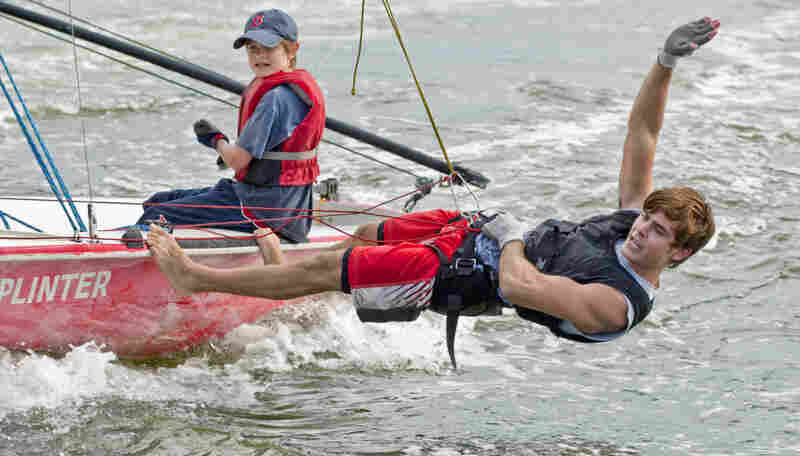 In this publicity image released by Universal Pictures, Charlie Tahan, left, and Zac Efron go sailing in Charlie St. Cloud.