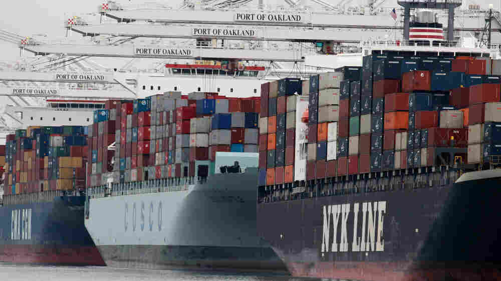 Container ships are positioned under cranes at the Port of Oakland in California. U.S. exports are up more than 30 percent from just two years ago, when President Obama set a goal of doubling U.S. exports in five years.