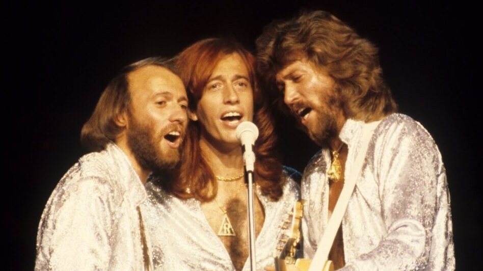 Robin Gibb (center) performs with brother Bee Gees Maurice (left) and Barry in 1979. Gibb died Sunday at the age of 62. (Redferns)