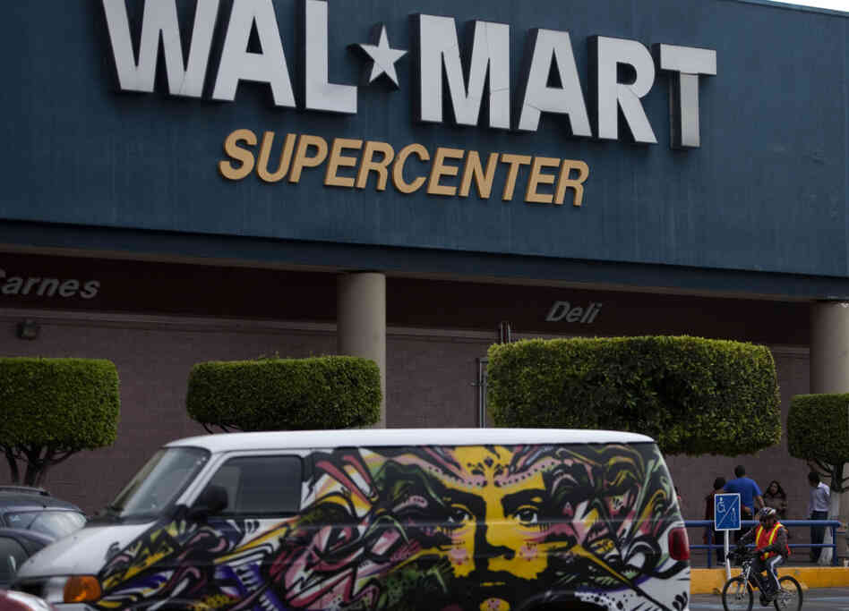 A van covered by a mural sits parked outside a Walt-Mart Super Center in Mexico City. Wal-Mart Stores Inc. hushed up a vast bribery campaign that top executives of its Mexican subsidiary carried out to build stores across Mexico, accor