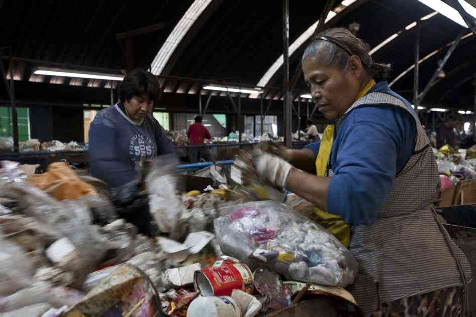 Sorters look for recyclables at the Bordo Poniente landfill on the outskirts of Mexico City, Mexico. The landfill has since been