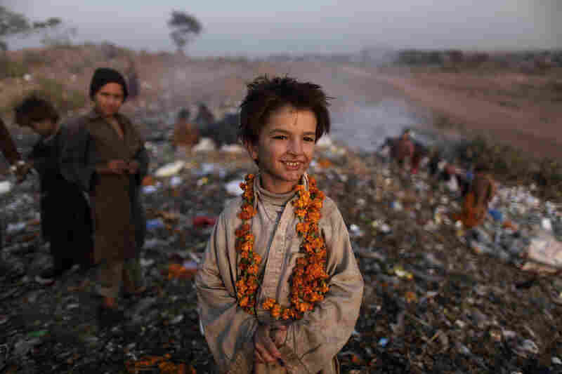 Afghan refugee Shafiq Mohammed, 9, and other children search through a dump on the outskirts of Islamabad, Pakistan.