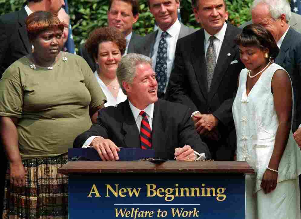 President Clinton prepares to sign legislation overhauling America's welfare system at the White House Rose Garden on Aug. 22, 1996. Today, the ranks of the nation's poor have swelled to a record 46.2 million — nearly 1 in 6 Americans — as the prolonged pain of the recession leaves millions still struggling and out of work.