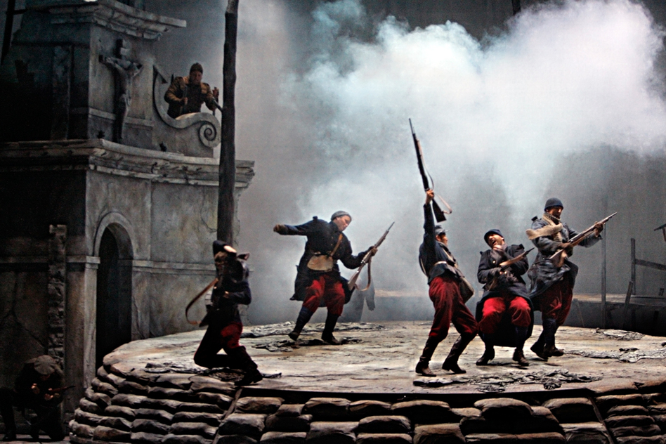 Shots are fired as the French and Scottish soldiers fail miserably in their attempt to storm a German bunker. (Minnesota Opera)