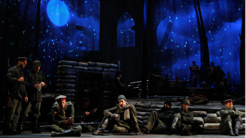 "In the French bunker, the soldiers are tired and dragging. They sing the ""Sleep Chorus"" as snow begins to fall. (Minnesota Opera)"