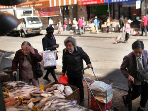Elderly women walk by a fish market April 19, 2012 in the Chinatown neighborhood of New York City. According to an analysis by the city's Center for Economic Opportunity, the number of New Yorkers classified as poor in 2010 rose by nearly 100,000 from the year before, increasing the poverty rate by 1.3 percentage points to 21 percent.