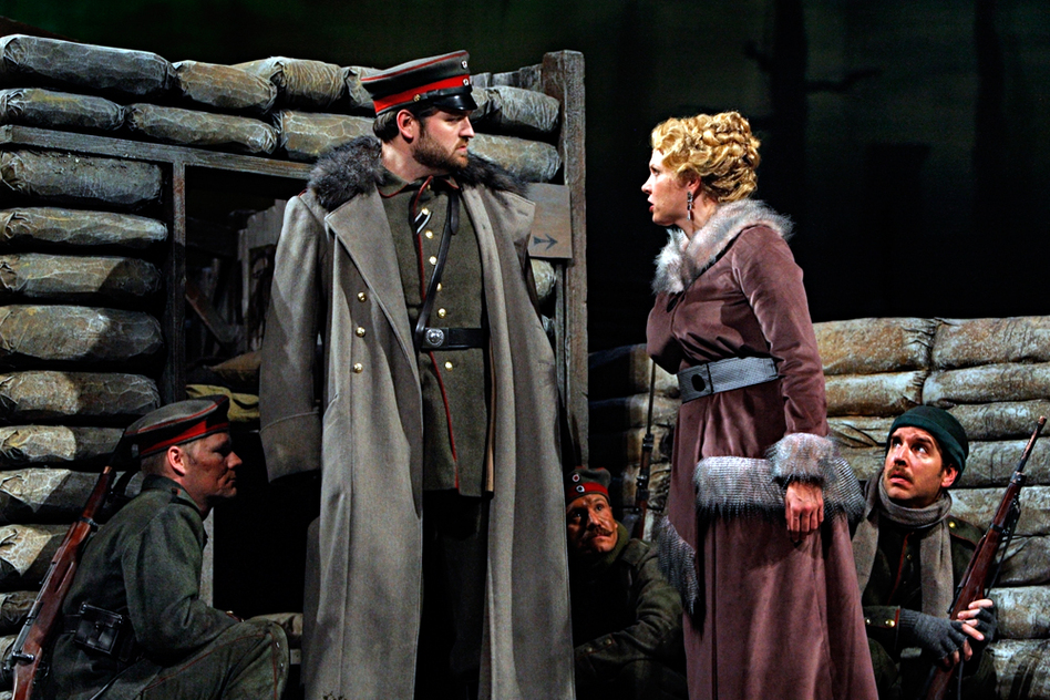 Anna Sørensen (Karin Wolverton) tells the German Lieutenant Horstmayer that she and her lover, Nicholas Sprink, are prepared to defect and turn themselves into the French as prisoners of war. (Minnesota Opera)
