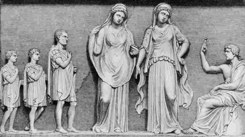 A father and his two sons consulting the oracles of Apollo at Delphi in ancient Greece, circa 600 B.C.