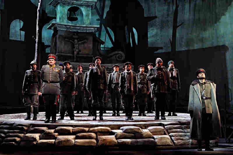 Near the end of the opera, the German soldiers — led by A. J. Glueckert as Kronprinz, son of Kaiser Wilhelm II (far right), and Craig Irvin as Lieutenant Horstmayer (left) — prepare to be shipped off to the Russian front.