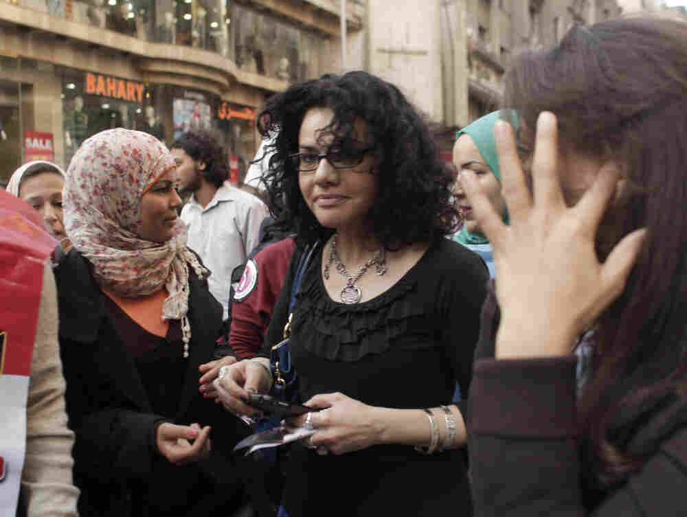 Mona Eltahawy (center), a prominent Egyptian-born, U.S.-based columnist, and Egyptian activist Samira Ibrahim (left) march in downtown Cairo to mark International Women's Day in March.
