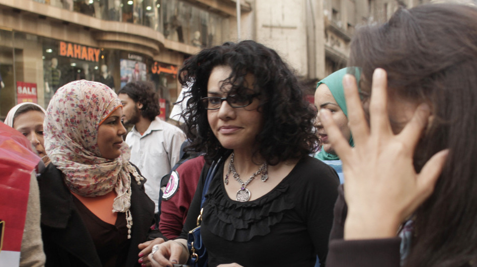 Mona Eltahawy (center), a prominent Egyptian-born, U.S.-based columnist, and Egyptian activist Samira Ibrahim (left) march in downtown Cairo to mark International Women's Day in March. (AP)