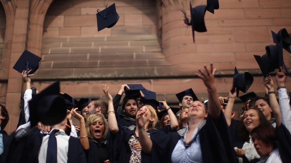 Students from John Moores' University celebrate graduation. (Getty Images)