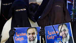 During a demonstration at Cairo's Tahrir Square last week, veiled Egyptian women hold posters supporting Muslim cleric Hazem Abu Ismail, an ultra-conservative preacher who was disqualified from running for the presidential elections on technical grounds.