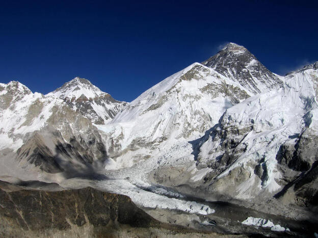 In this undated picture, Mount Everest, the world's tallest mountain at 29,029 feet, stands behind the Khumbu Glacier, one of the longest glaciers in the world. Nepal has more than 2,300 glacial lakes, and experts say at least 20 are in danger of bursting.
