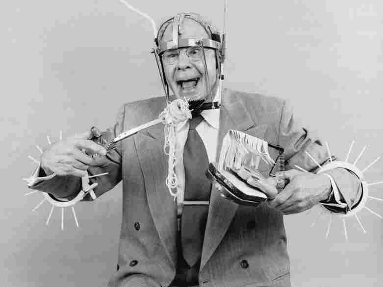 Russell E Oakes, an amateur American inventor wearing his problem solving inventions.