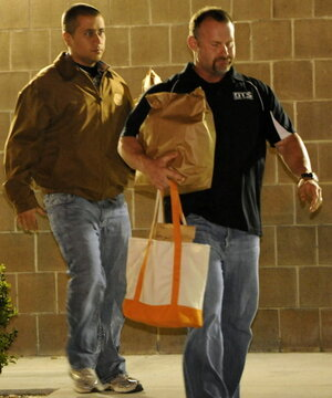 George Zimmerman, left, as he walked out of jail earlier today. The other man was not identified.