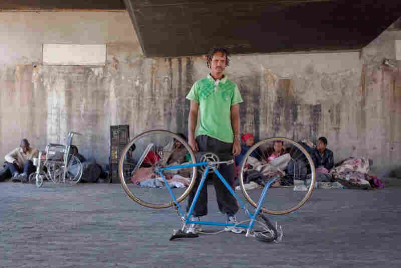 "Henry Nxumalo: ""I was brought here by social workers because of circumstances of life, home problems and so on, so I came here to Cape Town and I found myself on the streets. Things are not going very well actually, but bicycle riding is one of my dreams. ... This bike is called Roro. I named it after my son."""