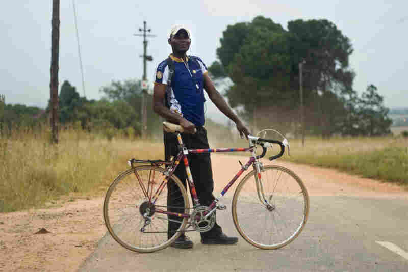 "Melusi Ndlovu: ""I like to be in competition racing; I feel strong on this bike. I'm going to work now, working as a security guard. I use the bicycle everyday. Bought it from another guy. His employer gave it to him. Now I've had it for two years."""