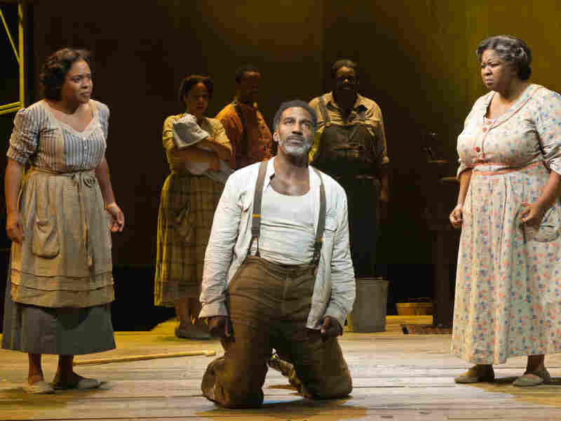 In Porgy and Bess, Serena (Bryonha Marie Parham) and Maria (NaTasha Yvette Williams) give Porgy (Norm Lewis) some distressing news. The show is is playing at the Richard Rodgers Theatre.