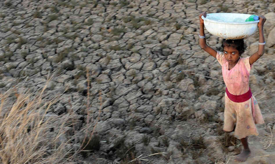 Access to fresh water is not a given for many, including this Indian girl carrying bottles of drinking water filled from a municipal tap two kilometers from her village.