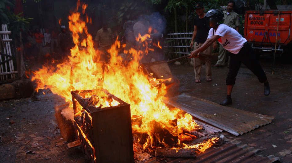 Local officials burn chicken coops in anticipation of a resurgence in bird flu in Jakarta, Indonesia, in January. Concerns about potential misuse of research into genes that control the contagiousness of flu have stymied publication.