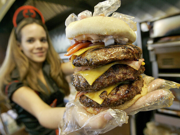 """One of the Heart Attack Grill's """"triple bypass"""" burgers."""