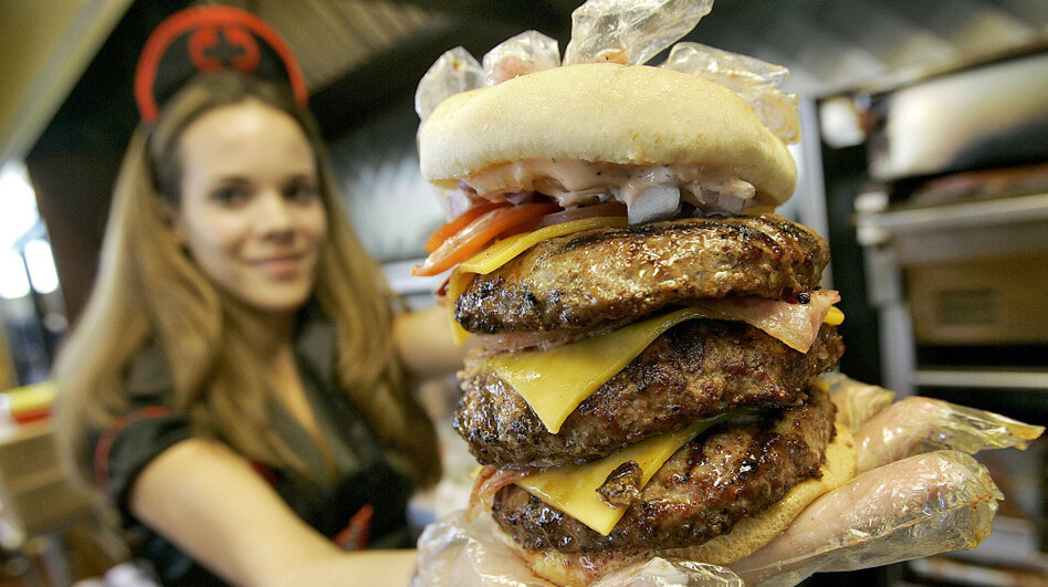 """One of the Heart Attack Grill's """"triple bypass"""" burgers. (AP)"""