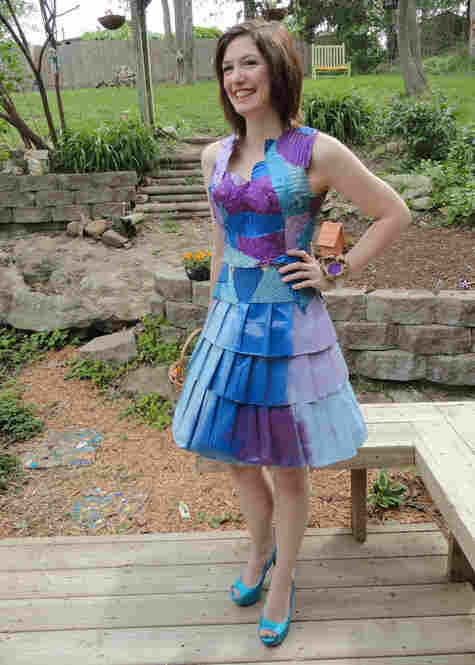 """Maura Pozek poses in her prom dress made out of corrugated cardboard, paper bags and """"lots of hot glue""""."""