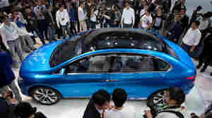 China is now the world's largest market for cars, and the Auto China 2012 car show is now taking place in Beijing. Here, the Denza electric car, a joint creation by Daimler and Chinese manufacturer BYD, is unveiled Monday.