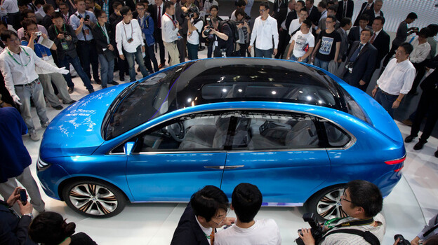China is now the world's largest market for cars, and the Auto China 2012 car show is now taking place in Beijing. Here, the Denza electric car, a joint creation by Daimler and Chinese manufacturer BYD, is unveiled Monday. (AP)