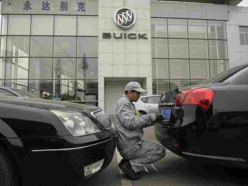 A mechanic works on a Buick at a General Motors dealership in Shanghai last December. GM just announced it plans to open 600 additional dealerships in China. The company now sells more cars in China than it does in the United States.