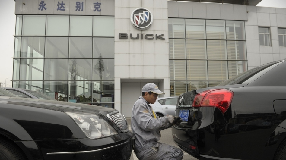 A mechanic works on a Buick at a General Motors dealership in Shanghai last December. GM just announced it plans to open 600 additional dealerships in China. The company now sells more cars in China than it does in the United States. (AFP/Getty Images)
