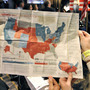 Onlookers study a map of the electoral college system during a Nov. 5, 2008, U.S. presidential election party in Brussels. This year, the electoral vote landscape could be more challenging for Mitt Romney than national popul