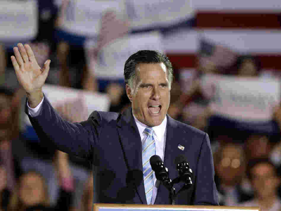 Former Massachusetts Gov. Mitt Romney takes the stage at an election night rally in Manchester, N.H., on Tuesday night. Romney won nominating contests in Pennsylvania, Rhode Island, Connecticut and Delaware.