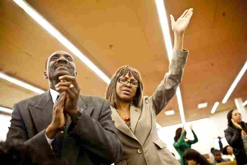 """Natasha and Curtis pray during Sunday worship at The Sanctuary Baptist church in Capitol Heights, Md. """"She is always trying to take care of someone or something — a dog, a cat, a bird,"""" Franklin says of Natasha. """"She has been that way since she was knee-high."""""""