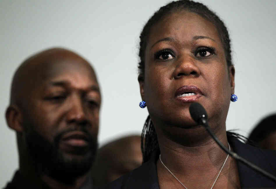 Sybrina Fulton, mother of Trayvon Martin, speaks as Trayvon's father Traci Martin listens.