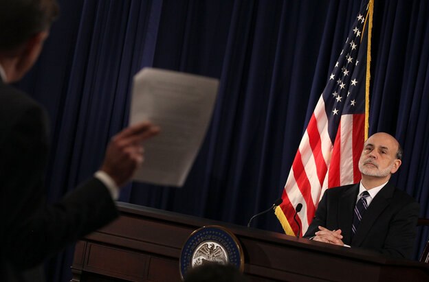 Federal Reserve Chairman Ben Bernanke listens to a question from a reporter during a press briefing at the Federal Reserve building on Wednesday.