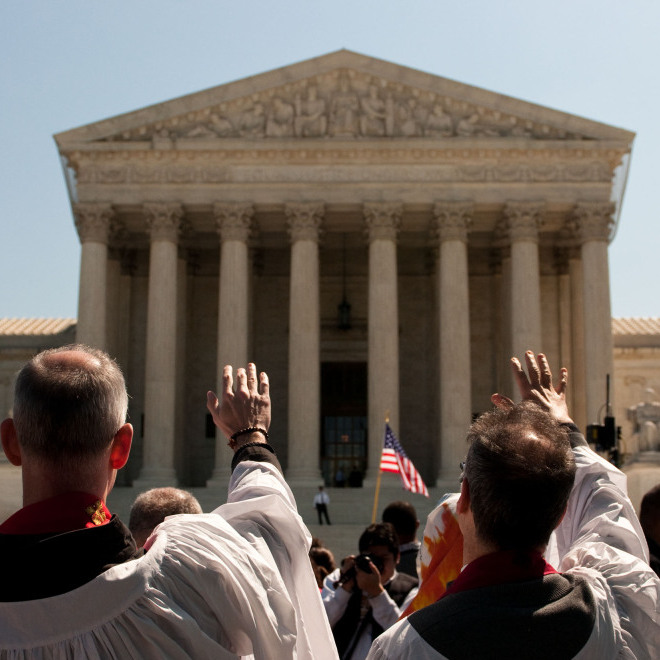 "A group dressed in robes parades in silence around the Supreme Court building in a Bible-inspired ""Jericho Walk."""
