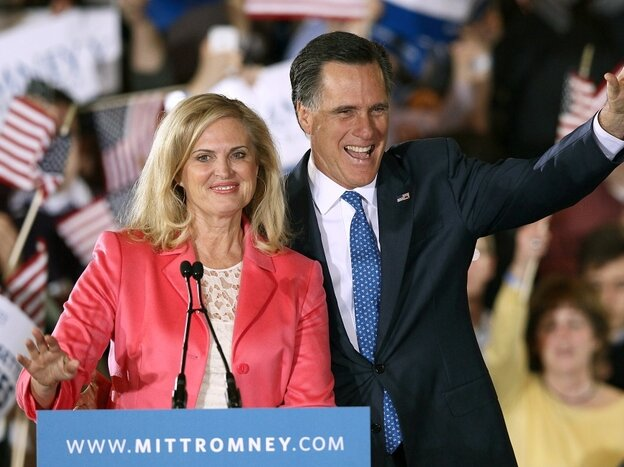 Ann Romney stands next to her husband and presidential candidate Mitt Romney.