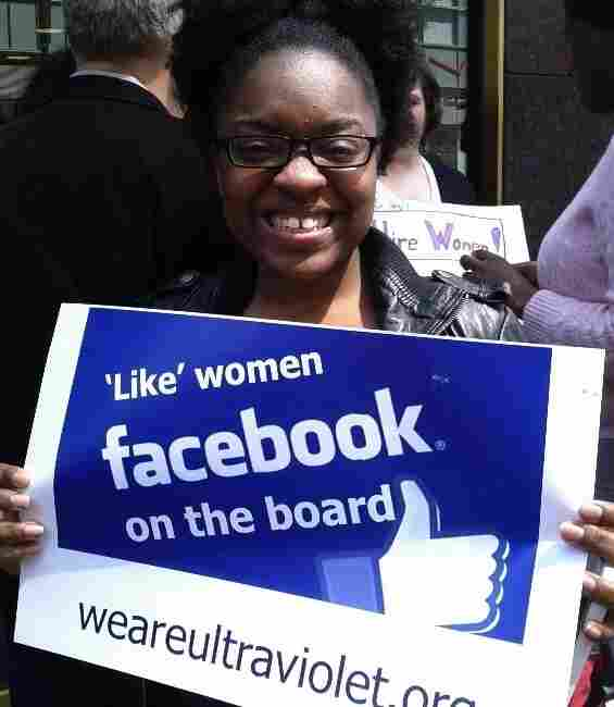 A protester holds a sign in front of Facebook's New York offices.