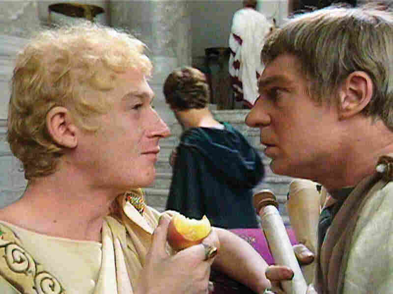 John Hurt (Caligula) and Derek Jacobi (Claudius) square off in the miniseries I, Claudius.