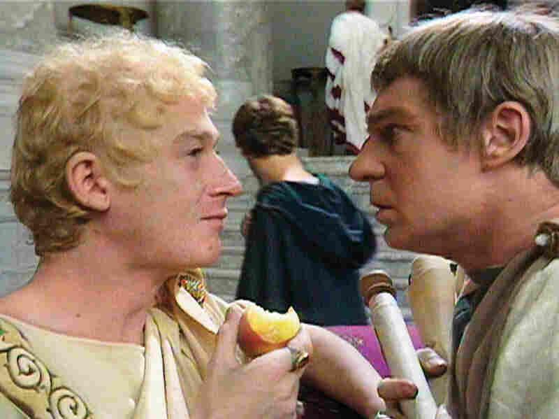 John Hurt (Caligula) and Derek Jacobi (Claudius) square off in the miniseries I, Claudius.