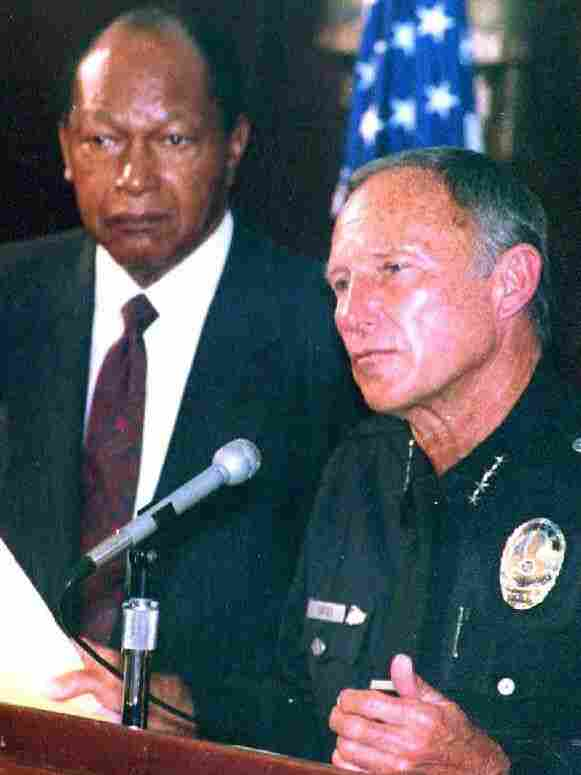 LAPD Chief Daryl Gates (right) and Los Angeles Mayor Tom Bradley respond to the rioting that began on April 30, 1992, after four police officers were acquitted in the beating of Rodney King.