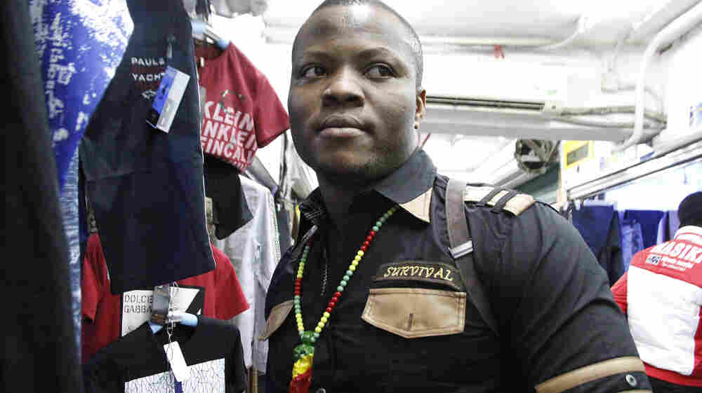 "In the southern Chinese city of Guangzhou, thousands of African immigrants, many of them small-scale clothing traders from Nigeria, have come seeking business opportunities. One of the Nigerian traders, who goes by his ""designer name"" of Niceguy, is shown here in the city's Little Africa neighborhood."