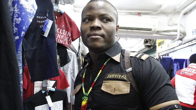 """In the southern Chinese city of Guangzhou, thousands of African immigrants, many of them small-scale clothing traders from Nigeria, have come seeking business opportunities. One of the Nigerian traders, who goes by his """"designer name"""" of Niceguy, is shown here in the city's Little Africa neighborhood. (Nina Porzucki for NPR)"""