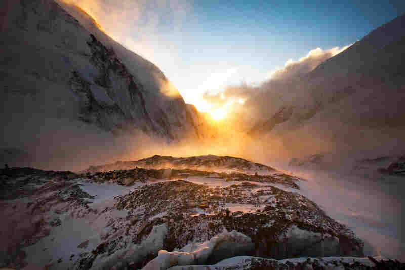 The sun sets over the west shoulder of Everest (right) and Nuptse, a neighboring peak, April 24.