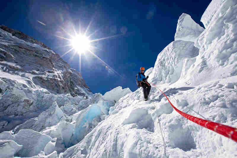 Expedition leader Conrad Anker descends an ice step in the Khumbu Icefall, April 19.