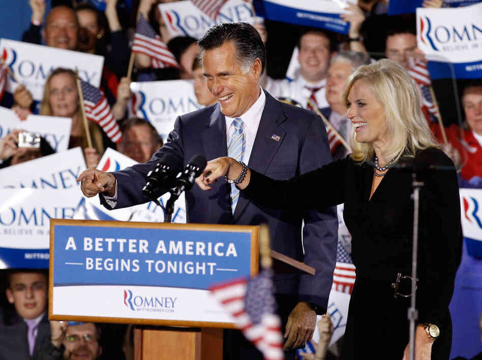 Republican presidential candidate Mitt Romney and his wife Ann celebrated Tuesday night in Manchester, N.H.