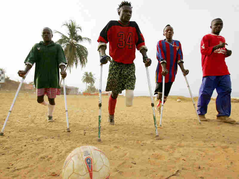 Members of a civil war amputee soccer team practice on a beach in Freetown, Sierra Leone's capital, in April 2006. Rebel groups, allegedly aided by former Liberian President Charles Taylor during Sierra Leone's brutal 1991-2002 civil war, were known for their gruesome practice of hacking off limbs.